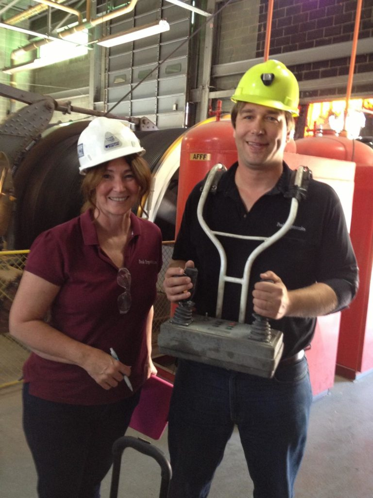 Kelly and Paul with Peak Ergonomics wearing safety gear